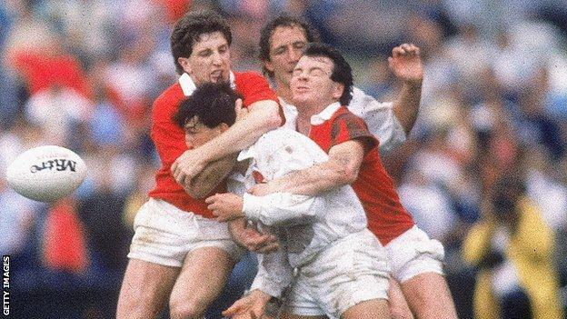 Jonathan Davies and Ieuan Evans get to grips with England at the 1987 World Cup