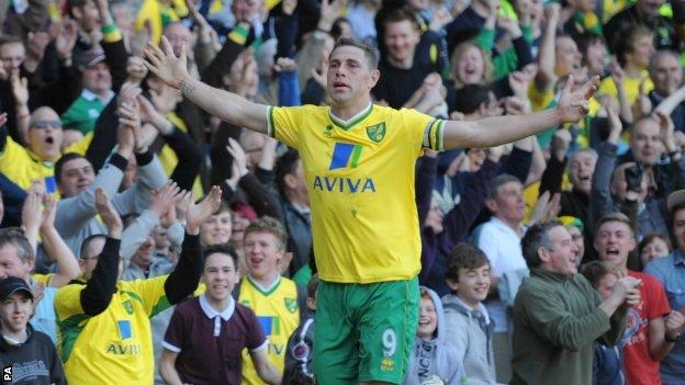 Grant Holt celebrates scoring his first goal