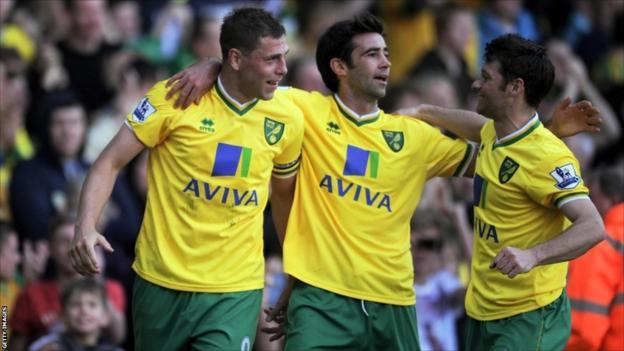 Grant Holt (left) celebrates scoring against Wolves