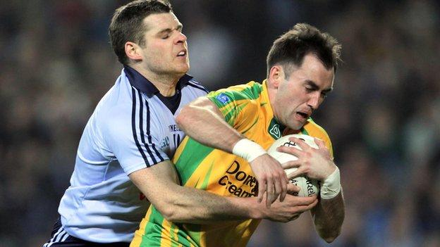 Dublin's Kevin McMenamon tackles Karl Lacey in the league clash