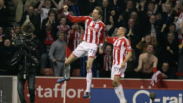 Stoke City's Peter Crouch celebrates scoring their first goal of the game with team-mate Jonathan Walters (right)