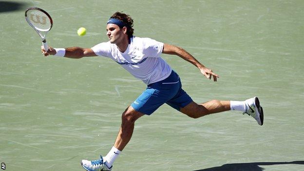 Roger Federer in action against Harrison