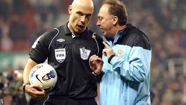 Manchester City coach David Platt (right) talks with referee Howard Webb after the draw at Stoke