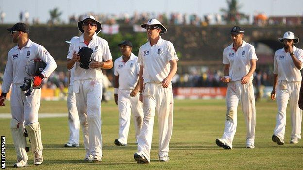 England players leave the field after a fluctuating opening day in Galle