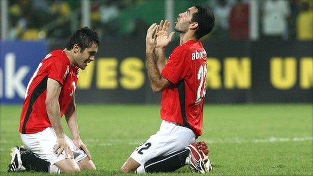 Mohamed Aboutrika - seen here celebrating Egypt's 2008 Nations Cup success - is back in the squad, but Ahmed Hassan (left) misses out