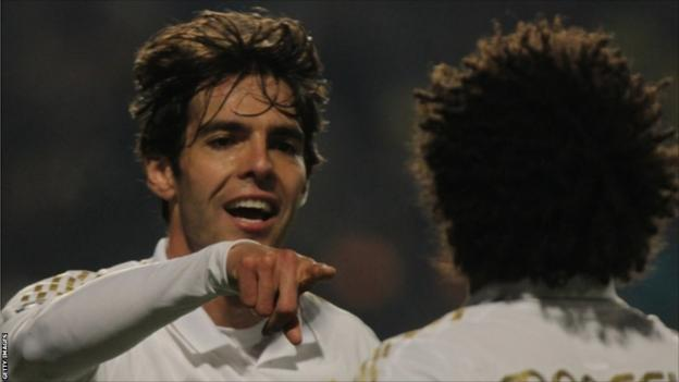 Real Madrid's Brazilian midfielder Kaka celebrates with team mate Real Madrid's Brazilian defender Marcelo after scoring a goal