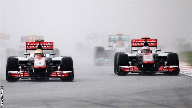 Lewis Hamilton (centre) of Great Britain, McLaren and Jenson Button (right) of Great Britain