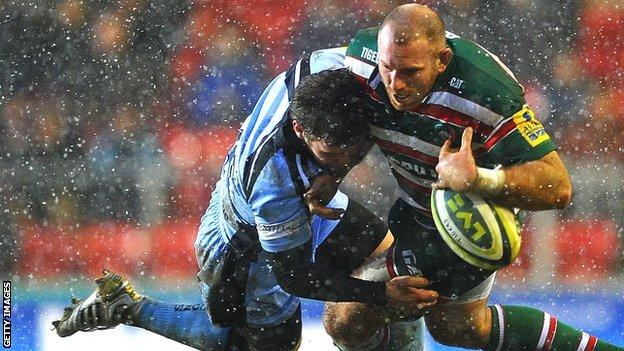 Leicester's Rob Hawkins (right) is tackled by Will Chudley of Newcastle