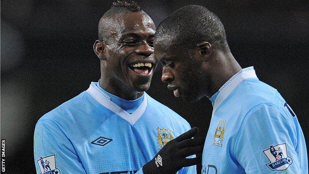 Manchester City's Mario Balotelli and Yaya Toure