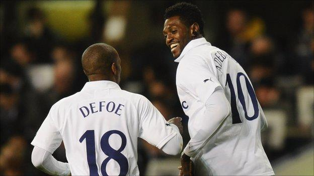 Emmanuel Adebayor celebrates a goal with Tottenham Hotspur team-mate Jermain Defoe