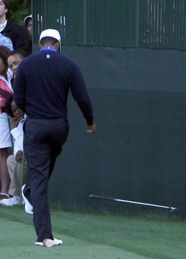 Tiger Woods kicks his club