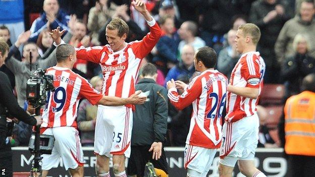 Peter Crouch (second-left) is congratulated by team-mates