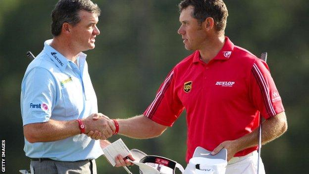 Lawrie and Westwood shake hands at the end of the final round at the Masters