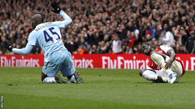 Mario Balotelli (left) was dismissed at Arsenal after receiving two yellow cards