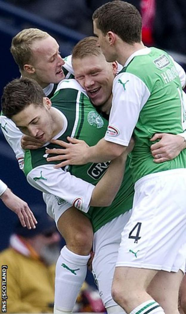 Grifiths and O'Connor help celebrate the latter's opening goal at Hampden