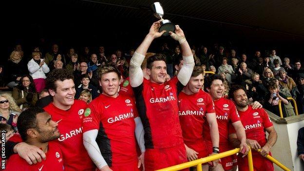 Saracens celebrate winning the Melrose Sevens