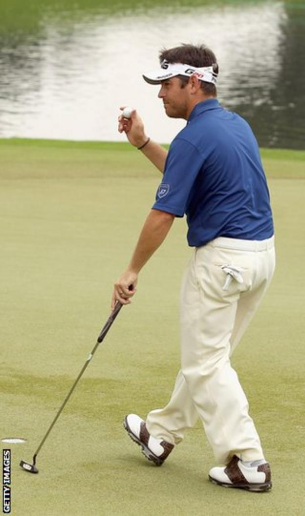 Oosthuizen celebrates after holing his final putt at the Malaysian Open