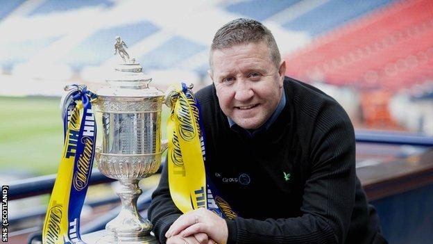 Former Hearts striker John Robertson with the Scottish Cup