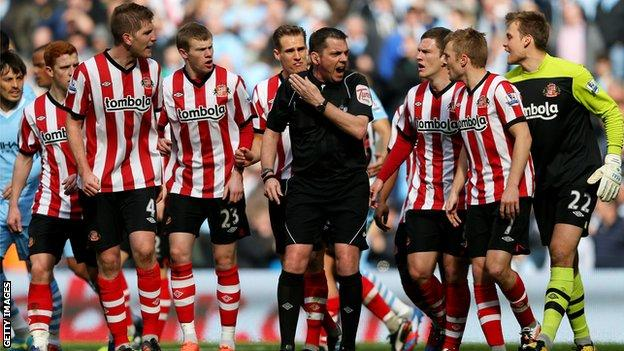Sunderland players react to a penalty decision against Manchester City