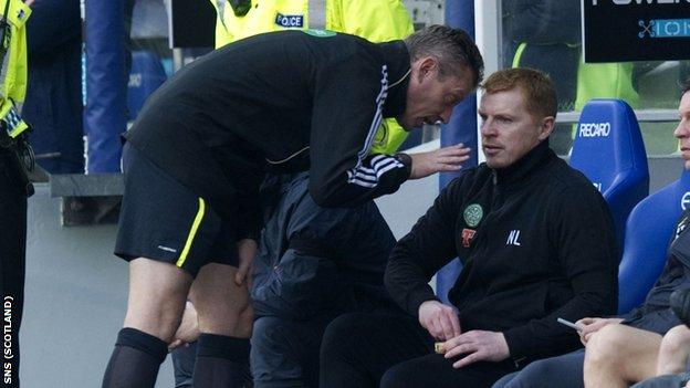 Fourth official Iain Brines (left) has words with Celtic manager Neil Lennon