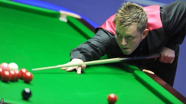 Mark Allen plays a shot in Saturday's first session at the Crucible