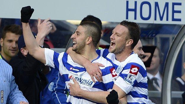 Adel Taarabt celebrates his goal against Tottenham with Clint Hill