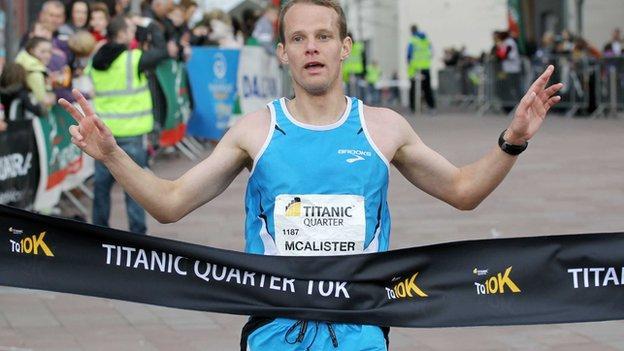 Joe McAlister crosses the finishing line