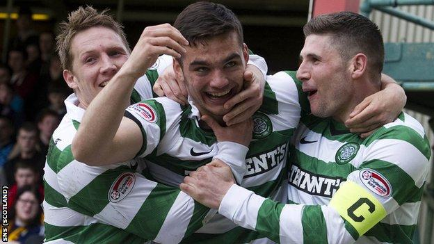 Celtic's Tony Watt (centre) celebrates opening the scoring with team-mates Gary Hooper (right) and Kris Commons
