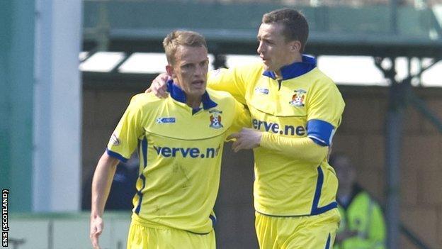 Kilmarnock penalty scorer Dean Shiels is congratulated by James Fowler