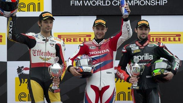 Jonathan Rea [centre] celebrates his Assen win on the podium with Eugene Laverty [right] and Sylvain Guintoli