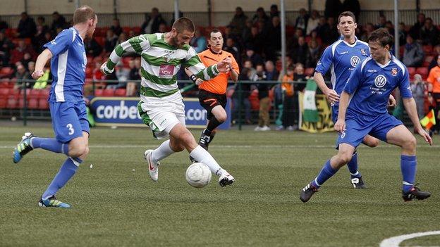 Greg Draper takes on Bangor City's defence