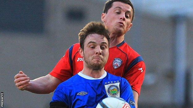 Jamie Mulgrew battles with Ruairi Harkin at Windsor Park