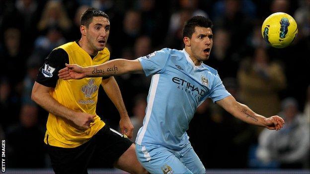 Blackburn Rovers defender Bradley Orr (l) challenges Sergio Aguero