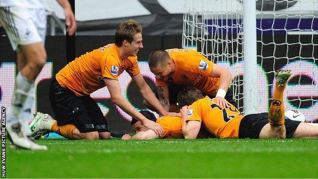 Goal-scorer Matt Jarvis is mobbed by his Wolves team-mates