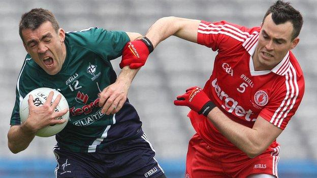 Johnny Doyle battles with Cathal McCarron at Croke Park