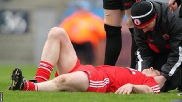 Tyrone's Aidan Crory had to be stretchered off at Croke Park with an apparent leg injury