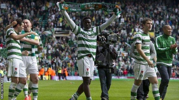 Celtic's players celebrate at the end of their 3-0 win over Rangers