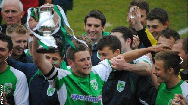 Guernsey skipper Sam Cochrane lifts the Combined Counties League Division One trophy