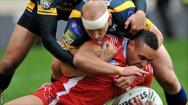Salford and Leeds in action during their Challenge Cup fifth-round tie