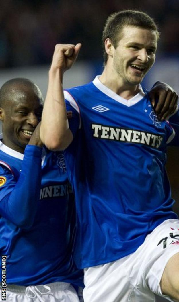 Aluko and Ness celebrate the latter's goal against United