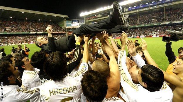 Jose Mourinho held aloft by Real Madrid players