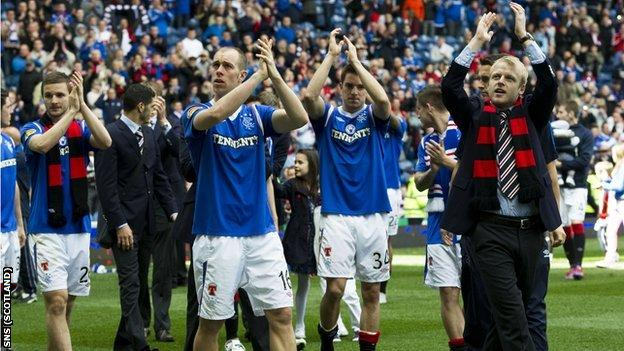 Rangers players applaud their fans after their final home match of the season