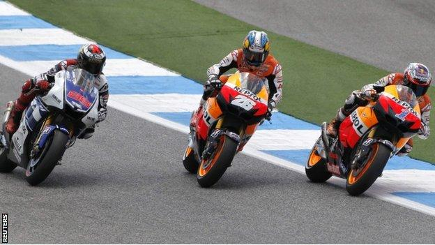 Jorge Lorenzo (left), Dani Pedrosa (middle) and Casey Stoner (right) battle for the lead at the Portugal MotoGP