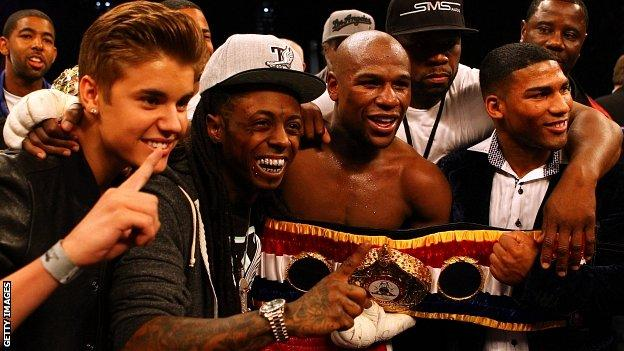 "Singer Justin Bieber, Rapper Lil Wayne, boxer Floyd Mayweather, rapper Curtis ""50 Cent"" Jackson and guest pose after Mayweather's win over Miguel Cotto"