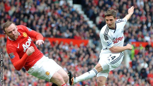 Joe Allen, Swansea City, and Wayne Rooney, Manchester United