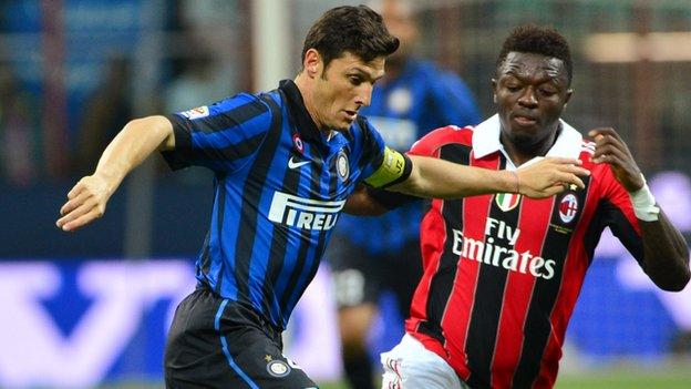 Sulley Muntari (right) was racially abused by some fans of his former club, Inter Milan