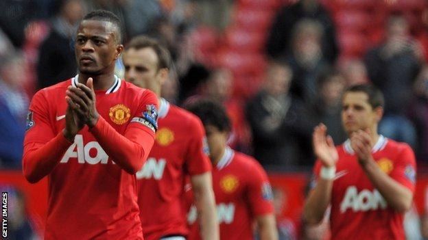 Patrice Evra applauds fans after Sunday's 2-0 win over Swansea