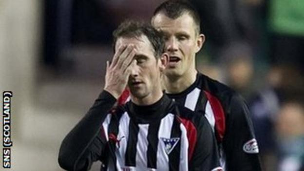 Dunfermline players look dejected after their relegation from the SPL is confirmed
