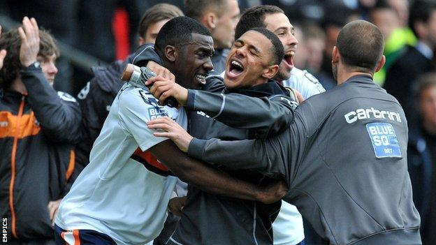 Luton players celebrate at the Racecourse Ground