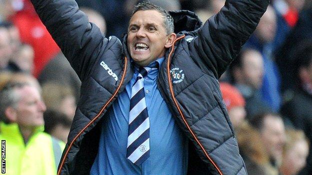Paul Buckle celebrates guiding Luton into the play-off final.